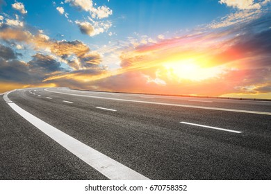 Asphalt road and sky cloud landscape at sunset