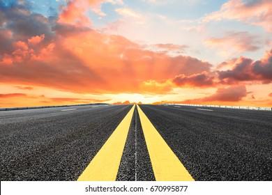 Asphalt road and sky cloud landscape at sunset