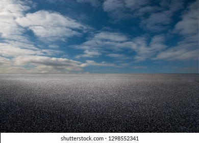 Asphalt road and sky clouds background