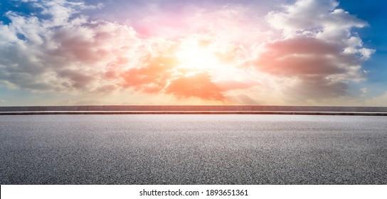 Asphalt road and sky clouds at sunset.Road background.