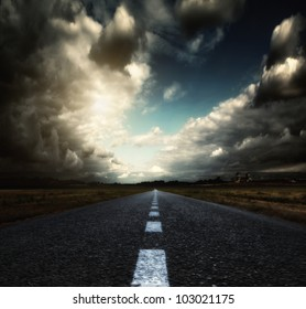 Asphalt road and sky. Shallow depth of field