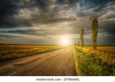 Asphalt road in sunset