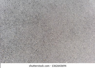 Asphalt road surface.