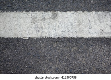 Asphalt road texture background,select focus with shallow depth of field:ideal use for background.