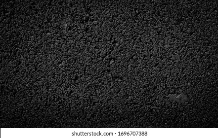 asphalt road texture of the tarmac, top view. - Shutterstock ID 1696707388
