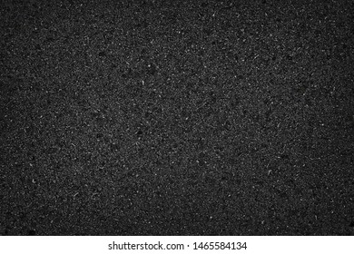 Asphalt road texture with vignette for design backdrop or overlay design road surface top view