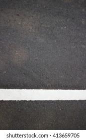 Asphalt road texture with white line