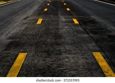Asphalt road texture with yellow line    art