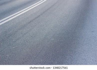asphalt road textured perspective surface with marking in corner of picture transportation and infrastructure background pattern with empty copy space for text or inscription