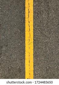 Asphalt road top view. Highway yellow line marks.