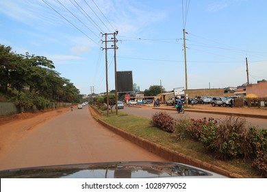 Asphalt road and traffic flow in Africa. Typical street life in Uganda. African town. A landscape photo of Uganda's city, Kampala: 4 June 2016