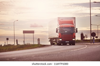 asphalt road with a truck. lorry moving on sunny evening