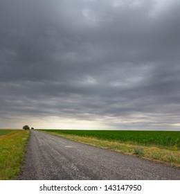 asphalt road under a dense clouds