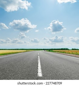 asphalt road with white line to cloudy horizon