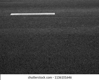 asphalt road with white line texture