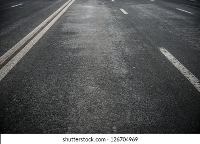 Asphalt road with white stripes