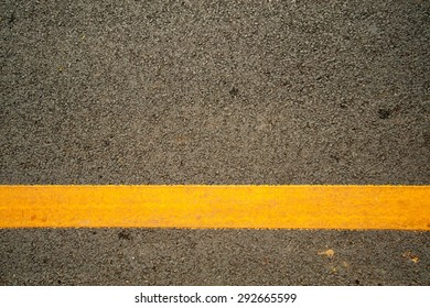 The asphalt road and yellow line