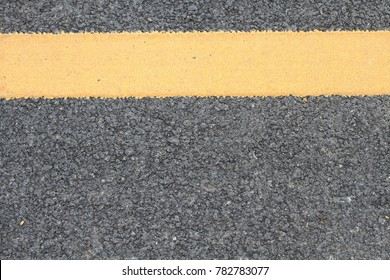 asphalt road and yellow line background with space for text