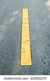 Asphalt road with yellow line sign.selective focus for background texture.