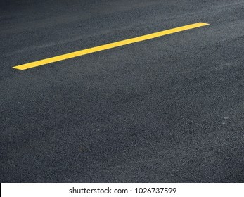 asphalt road with yellow line texture