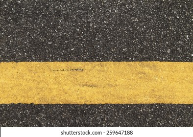 Asphalt road with yellow line texture background