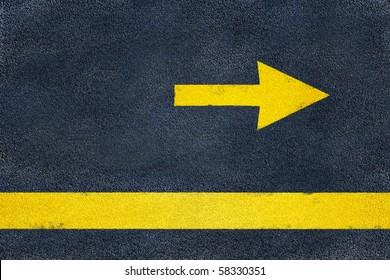 Asphalt road yellow marking. Direction arrow