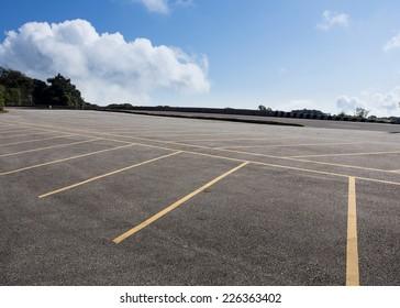 asphalt roadway parking lot with cloud blue sky background
