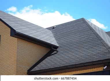 Asphalt shingles roofing construction, repair.  Problem Areas for House asphalt shingles Corner Roofing Construction Waterproofing. Rain gutter system.