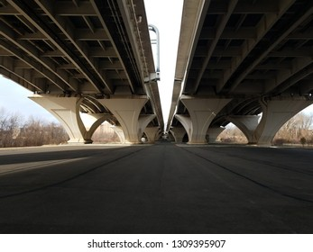 asphalt street under Wilson bridge in Virginia
