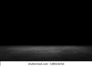Asphalt surface, racetrack on a black background