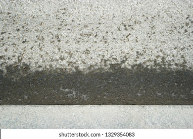Asphalt surface of the road and curbstone top view
