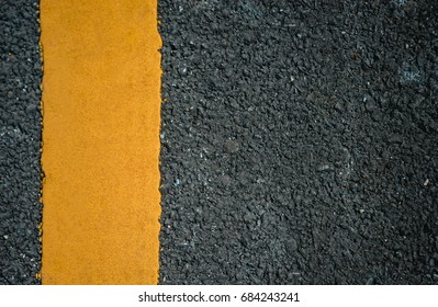 Asphalt surface road texture with Yellow lane line for background use.