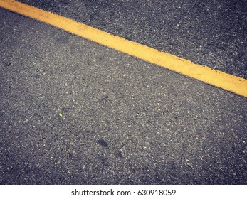 Asphalt surface with yellow line