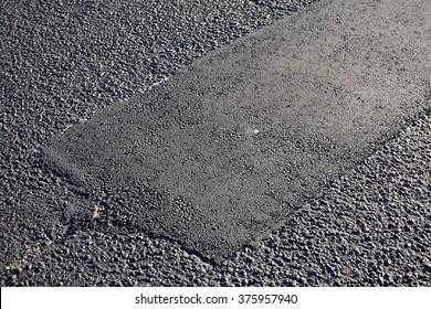 asphalt tarmac patch on concrete ground repair pavement road in parking lot