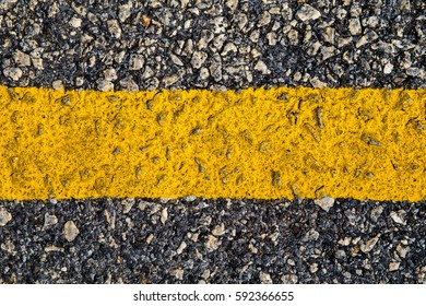 asphalt texture with yellow dashed line