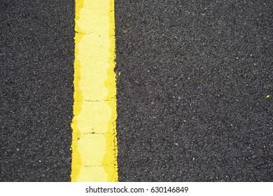 Asphalt texture. Yellow Line Asphalt Texture