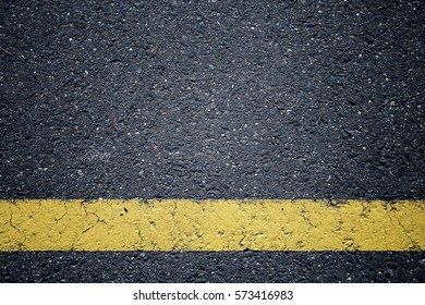 Asphalt texture. Yellow line on road