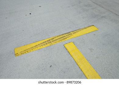 Asphalt tracks on a yellow stripe