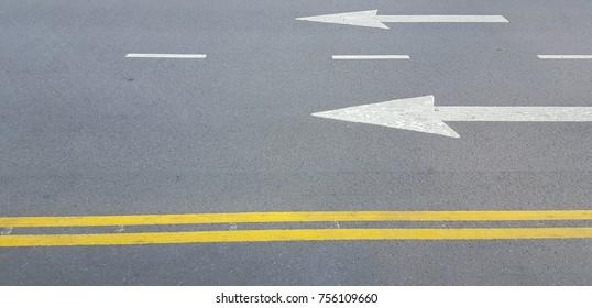 Asphalt traffic signs in the sunlight