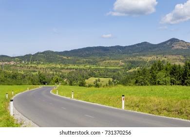 Asphalt, winding road near the town of Postojna in Slovenia.