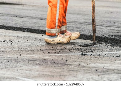 asphalt worker wearing Dutch wooden clogs