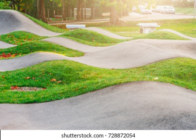 Asphalted bicycle race track, pump track, kids playground