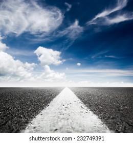 asphalted highway over blue sky background