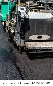 Asphalting machine on the road. Close up