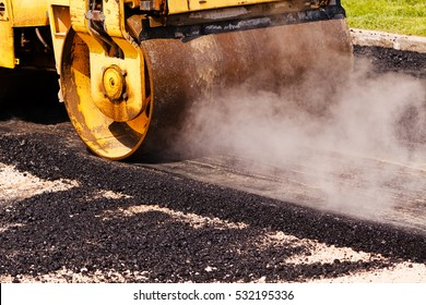asphalting of the road with steamroller