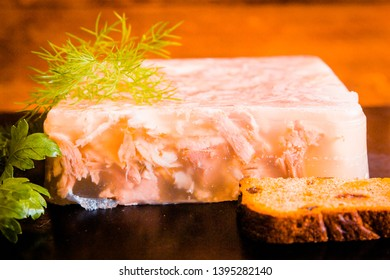 aspic from beef pork and chicken on the table. appetizer of Ukrainian, European cuisine. jelly