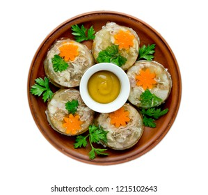 Aspic jellied meat with vegetables on plate top view isolated on white background