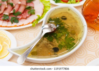 Aspic from meat decorated with parsley on a festive table