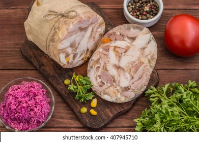 Aspic with meat and horseradish on a wooden table