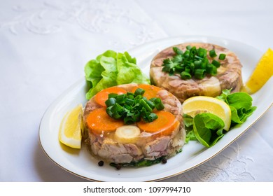 Aspic, pork meat in gellatine. Traditional Polish food. Often served with vodka.